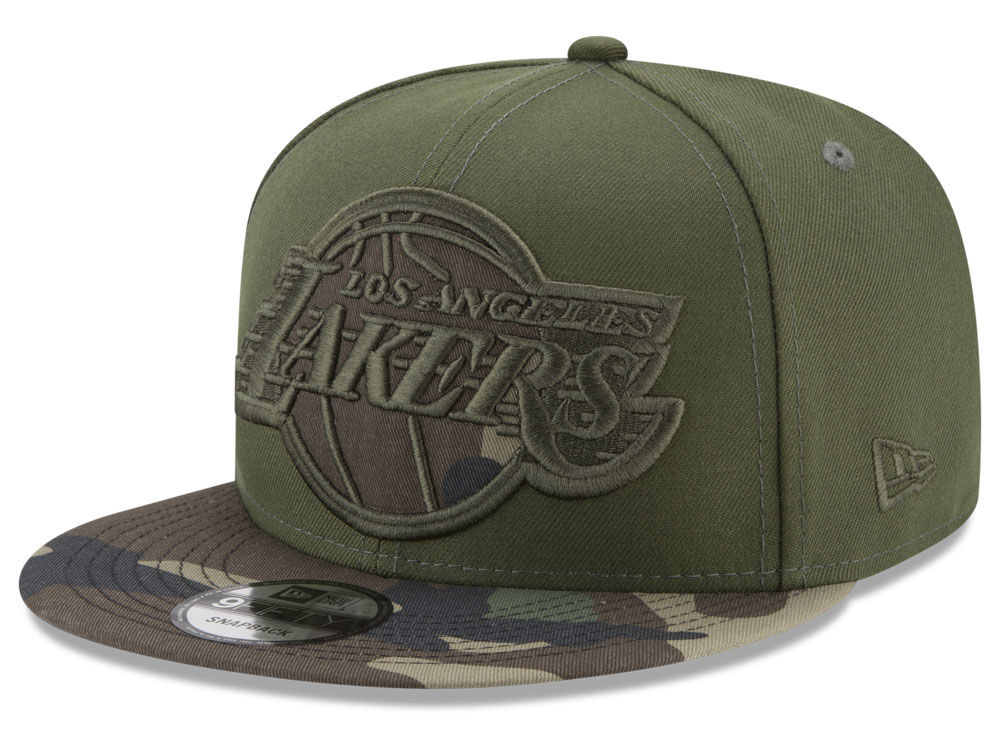 Los Angeles Lakers New Era NBA Operation Camo 9FIFTY Snapback Cap ... 3b4e237dcb5f