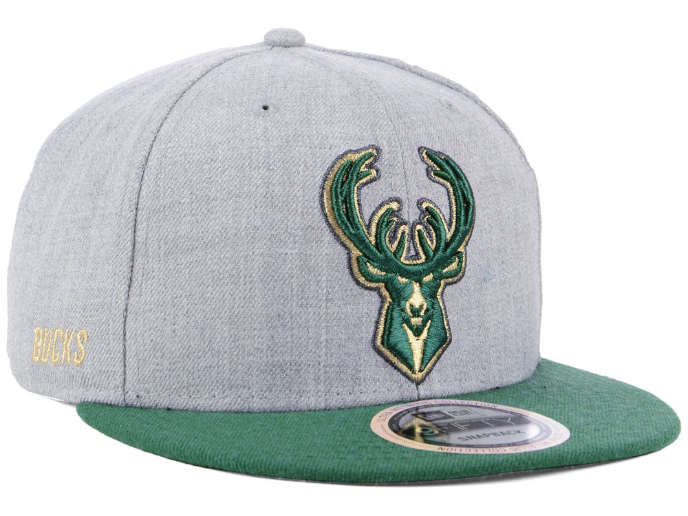 c38caa4e Milwaukee Bucks New Era NBA Heather Metallic 9FIFTY Snapback Cap | lids.com