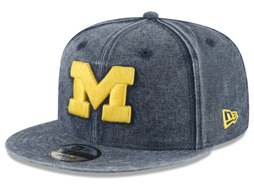 770f9a0af79 Michigan Wolverines New Era NCAA Rugged Canvas 9FIFTY Snapback Cap ...